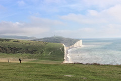 A fine autumn walk (larigan.) Tags: sea man walking memorial shore recreation sevensisters eastsussex southdowns englishchannel beachyhead birlinggap lamanche chalkcliffs modelreleased belletoutlighthouse larigan phamilton