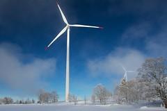 Wind mill eating clouds (grey_tie) Tags: trees winter snow windmill clouds wind bluesky jura breuleux