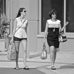 SHOPPING (simongavin83) Tags: street ladies blackandwhite woman hot girl sunglasses lady shopping bag walking women warm sandals candid daughter mother streetphotography sunny flipflops bags handbag streetview carrying sunshades