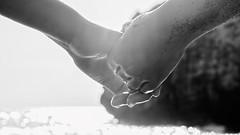 What I found at the bottom of the ocean (PokemonaDeChroma) Tags: handinhand togetherness hands holding tresor backlighting ensemble sea sandy sand contrejour noiretblanc wtbw maindanslamain mains tangan bergandengan kebersamaan bnw
