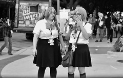 Ready For Another Waffle? (burnt dirt) Tags: houston texas downtown city town mainstreet street sidewalk streetphotography fujifilm xt1 bw blackandwhite girl woman people person animae cosplay costume uniform matsuri convention schoolgirl wafflebus waffle skirt stockings blackstockings bow glasses longhair shorthair purse bag cellphone phone group crowd foodtruck food discoverygreen georgerbrown