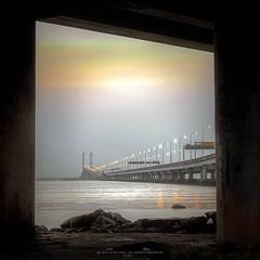 Penang Bridge (Ah Wei (Lung Wei)) Tags: 50mmf18g ahweilungwei bukitbendera butterworth georgetown georgetownpenang landscape malaysia nikon nikon50mmf18g nikond750 penang penangisland pulaupinang seascape seashore sunrise sunrises penangbridge frame gelugor my framing