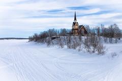 Spiritual outpost (Ulrich Neitzel) Tags: church eis frozen ice karesuando kirche lapland lappland mzuiko1250mm olympusem5 schnee schweden snow sverige sweden track tree weiss white winter