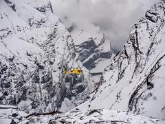 A rescue helicopter prepares to land and airlift 2 sick people of altitude sickness at Machapuchare Base Camp (CamelKW) Tags: abc annapurnabasecamptrek annapurnaregiontrek annapurnasanctuary fishtail kathmandu mbc machapuchare machapucharebasecamp nepal pokhara trekking