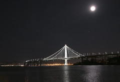 Eastern Span Oakland Bay Bridge (msuner48) Tags: d750 acr5 cs4 bridge baybridge water sanfranciscobay moon lights nightphotography topazlabs nikonafs24120mmf4ged