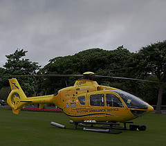 Air Ambulance (Brian Travelling) Tags: air ambulance helicopter aircraft emergency yellow glass rotors green trees sky pentaxkr pentax pentaxdal
