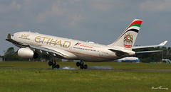 Etihad Airways A330-200 touching ground (birrlad) Tags: ireland dublin sunlight up airplane airport haze taxi aircraft aviation airplanes line landing heat approach takeoff runway airliner