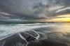 Weather (Nick Twyford) Tags: longexposure sunset sea newzealand seascape rock clouds blacksand nikon waves wideangle auckland nz northisland westcoast whatipu leefilters 1024mm d7000 lee09nd lee06gndhard