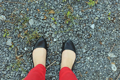 Two feet (RachelWolff72) Tags: red black feet stone shoes pair gravel apieceofme twofeet balletflats redjeans