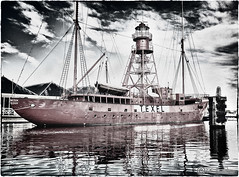 Texel Lightship (Studio Skwit) Tags: old light red sea panorama test lighthouse storm holland reflection art water netherlands colors dutch port photoshop 35mm vintage wow studio landscape island lights harbor boat photo crazy google cool nice aqua flickr experimental ship fuji view ships nederland experiment zee retro special fujifilm steven easy xxx try effect hdr texel lightship selective facebook denhelder wooow schepen xseries x100 twitter startcafe fujixseries skwit studioskwit stevensquid