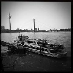 IMG_7994 (GodMadeMeFunky) Tags: city urban bw wheel river square space ferris german stadt nrw sw format dusseldorf dsseldorf rhine rhein riesenrad hipstamatic