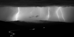 Through the Maw of Thunder (NicLeister) Tags: arizona bw white storm black mountains southwest nature weather clouds landscape desert sony united monsoon bolt strike thunderstorm states lightning alpha stormscape mazatzal a65 vision:mountain=0825 vision:outdoor=0518 vision:sky=0962 vision:clouds=0972