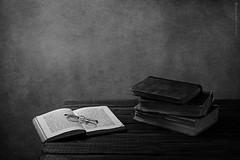 Monochrome Books (BronwynKatzke) Tags: monochrome stilllife books vintage anitque blackandwhite tabletop textured wall canon 50mm glasses