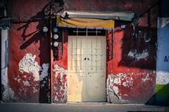 One door (Indrits) Tags: door red mxico rouge rojo puerta porte puebla medidor {vision}:{outdoor}=087 {vision}:{text}=0694