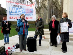Save the NHS: Louise Irvine speaks outside Parliament on February 27, 2014 (Andy Worthington) Tags: london westminster protest streetphotography parliament nhs banners placards sw1 hospitals politicalprotest andyworthington londonsw1 oldpalaceyard savethenhs boroughofwestminster louiseirvine savelewishamhospital clause119 clause118 carebill
