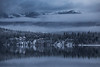 Bowron Lake Reflection (robertdownie) Tags: trees canada lake forest mountains winter water reflection cold clouds gold snow woods ice bc hills cabin wilderness british columbia remote mountans wells barkerville bowron cariboo