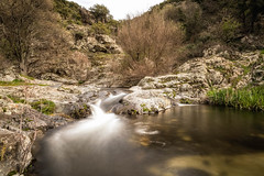Mountain stream cascading into a natural pool in Corsica (joningall) Tags: slowshutter rock pool winter stream fall whitewater waterfall clear cascade meander corsica france tree grass stone mausoleo reed corse fresh europe hill mountain river