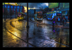 Tram or Bus? (Kevin, Mr Manchester) Tags: architecture building buses canon1855mm citycentre england hdr lancashire manchester northwest outdoor photoborder postprocessing transport tramlines tram reflections clouds
