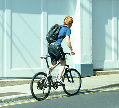 Cyclist (rosewoodoil) Tags: street blue ireland dublin canon cyclist streetphotography kitlens 200 200views 2880mm photographedublin somethingblueinmylife