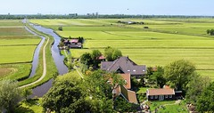 Rural Waterland in the near vicinity of Amsterdam Noord (Bn) Tags: blue summer sky lake holland green tower church water grass amsterdam skyline rural high