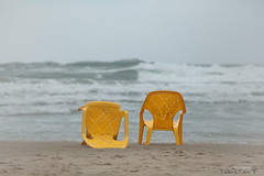 fall beach (Tania's Tales) Tags: street city sea urban stilllife abandoned beach yellow outside chair furniture empty pair streetphotography armchair exploration           fotografiastradale taniastales