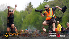fire jump (khoa_sus2) Tags: woman sports race zoom telephoto olympuspen monttremblant actionshot 40150mm f456 firejump mzuiko spartanrace epicactionimagery epl5 ericbolte
