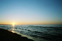 (theknark) Tags: sunset film water 35mm princeedwardisland analogue overexposure expiredfilm brackleybeach 2ev fujifilmnaturaclassica luckycharm200