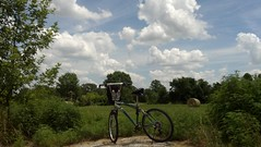 cycling under the skies of arkansas (under the skies of arkansas) Tags: skies farm side under here arkansas hay