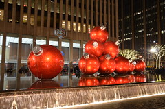 1251 Avenue of the Americas at the holidays (afagen) Tags: christmas nyc newyorkcity red sculpture newyork night manhattan rockefellercenter ornament gothamist radiocitymusichall exxonbuilding 1251avenueoftheamericas