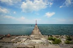 Tan (pantagrapher) Tags: summer people urban lake chicago tower beach clouds pier nikon michigan foster lakeshore tanning lakefront d600