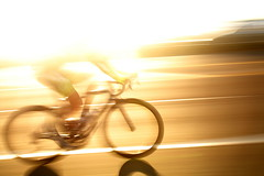 speed of light (JonathanCohen) Tags: sunset shadow sun motion blur bike bicycle silhouette speed cycling ride flare highkey panning coastroad photochallenge 2014photochallenge photochallenge2015calendar