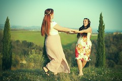 twirl (peculiarnothings) Tags: flowers friends portrait italy field daisies duo spin tuscany twirl carefree outsoors