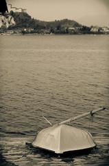 CONFINED (skech82) Tags: street bw italy white lake black castle lago 50mm boat blackwhite nikon barca italia foto streetphotography shore castello bianco nero biancoenero collina lagomaggiore remo blanckandwhite arona sponda fotodistrada d7000 skech82 skechphoto