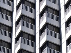 zigzag balconies - (Explore!) (Demetrios Lyras) Tags: windows bw abstract reflection building art architecture blackwhite angle fav50 financialdistrict explore balconies sfist fav10 fav5 fav25 sanfranciscocausa fav75 anglesanglesangles