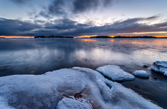 Winter Melancholy #02 (tinamar789) Tags: ice icy winter sea seascape seashore cold clouds rocks reflection blue darkening frost sunset snow horizon lauttasaari helsinki finland