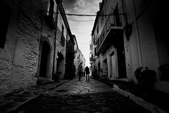 Narrow street (elgunto) Tags: street cadaqués people cobblestones light highcontrast catalunya españa blackwhite bw sonya7 nikon2035 ai manuallense digitalphoto