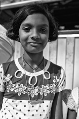Portrait of a Young Girl (alisdair jones) Tags: ef35mmf14lusm girl child portrait buddhist ruwanwelisaya anuradhapura srilanka