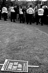 EDL Protest Leeds, Moortown (Ajay Kumar Photography) Tags: road people blackandwhite woman white man black english public control flag group protest police gathering violence british disorder fascism councilestate austerity edl stgeorgeflag