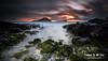 Makapuu Oahu Hawaii (Kiall Frost) Tags: ocean longexposure red orange sun storm black colour green beach water rain clouds sunrise hawaii lava rocks oahu le makapuu kiallfrost