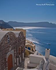 Across the Caldera to Imerovigli Santorini (Harvey Smith) Tags: blue brown white black mediterranean pentax yacht santorini greece caldera greekislands oia pentaxkm greekholidays harveysmithphotography cattermoran