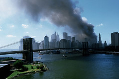NT5434607 (Globovisin) Tags: city newyorkcity bridge usa building water skyline architecture skyscraper river outdoors fire cityscape manhattan destruction smoke worldtradecenter 911 explosion terrorist nobody demolishing september burning criminal crime tragedy weapon disaster brooklynbridge eastriver terrorism violence northamerica newyorkstate emergency damaged bomb month suspensionbridge demolished bombing hazard lowermanhattan explosives trauma interaction attacking attacked traumatic destroying midatlantic hijacking socialissues collapsing emergencies urbanscene actofterrorism damaging sensitiveissue newyorkfinancialdistrict sensitiveissues destructionofworldtradecenter terroristattacksonus