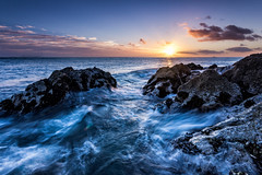 The Sun Will Rise (waltmanNZ) Tags: ocean blue newzealand summer seascape color water yellow clouds sunrise landscape coast october rocks long exposure waves 85mm east filter mussels graduated blend sigma1020mm ndfilter 2013 waihibeach cokinp canoneos60d