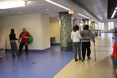 Fran walking with therapist. (tjacobs61) Tags: therapy prosthesis amputees