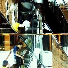 escalated (gregjack!) Tags: china light people colour reflection glass hongkong mirror escalator distrortion fragmentedrefelection