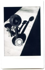 InstaxMonochrome006 Rotary Candlestick Phone (Johnny Martyr) Tags: rotarytelephone candlestickphone rotaryphone candlesticktelephone oldphone oldtelephone antiquephone antiquetelephone bw blackandwhitephotooftelephone bwphotographofoldtelephone contrast blackandwhite bwinstantfilm bwinstax fujiinstax fujiinstaxmonochrome fujiinstaxminineo90 fujiinstax90 neo90 lightandshadow classic antique vintage vintagephone vintagetelephone pictureofanoldtelephone pictureofanoldphone communication communications history historic film instantfilm fujifilm fujifilminstax fujifilminstaxmini fujifilminstaxmonochrome monochrome dial rotarydial brasstelephone blackandbrass keypad numbers numberdial mouthpeice mouthpiece handset microphone speaker talk listen speak ear mouth operator partyline earlytelephone