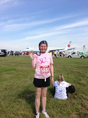 Lois and her medal (pigdump) Tags: tarmac race airplane airport medal runway 5k pearson yyz