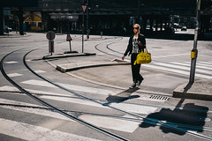 yellow x 3 (benowhere 3.0) Tags: light woman sun color yellow bag crossing streetphotography shade rails innsbruck