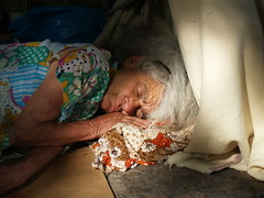 Homeless (iTimbo61) Tags: old travel sleeping portrait people woman travelling portugal portraits europe european lisboa lisbon homeless peaceful olympus wrinkles om1 wrinkled portugese e500 travelphotography olympuscameras