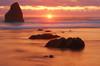 Oregon Orange (Erazzphoto) Tags: ocean travel sunset vacation art tourism beach water oregon landscape fun photography coast photo nikon photos pacificocean cannonbeach soe