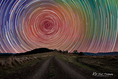 Star Trailing (Kiall Frost) Tags: road blue trees red orange white mountain color colour green water grass night fence way print photography star photo gate rocks long purple post image dam farm air trails australia dirt nsw outback milky gravel startrails nightscapes lostock kiallfrost